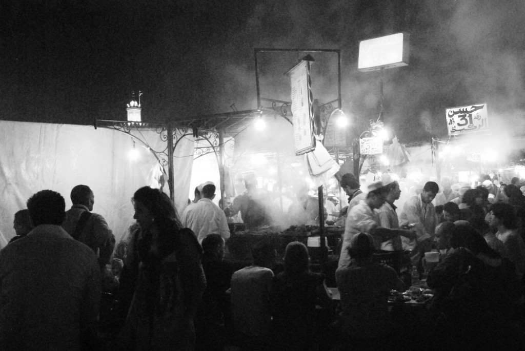 As the sun sets, smoke rises from the food stalls, turning the square into a huge busy open-air restaurant.